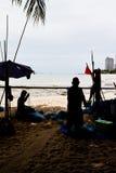 渔夫和捕鱼设备。 免版税库存图片