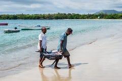 渔夫和金枪鱼 库存照片
