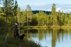 渔夫和风景 免版税图库摄影