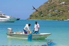 渔夫在托尔托拉岛,加勒比 免版税库存照片