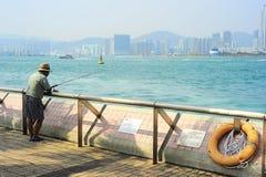 渔夫在香港 免版税库存照片