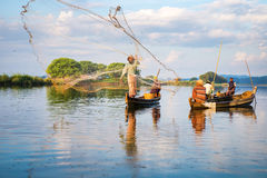 渔夫抓住鱼12月3日 免版税库存图片