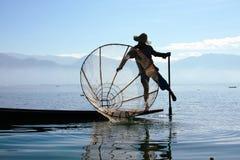 渔夫抓食物的鱼 免版税图库摄影