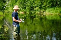 年轻渔夫渔耐心地 免版税库存图片