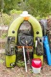 渔夫的轻的个人小船 免版税库存图片