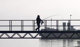 渔夫走 免版税库存照片