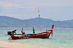 渔船在蓝色风平浪静 免版税库存图片