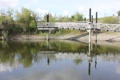 渔船坞舷梯和反射 免版税库存照片