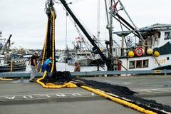 渔船装货网乘员组  图库摄影