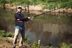 渔,有钓鱼竿的人 河,室外 图库摄影