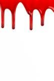 渗流在白色背景的血液 免版税库存照片
