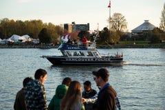 温哥华,BC,加拿大- 2019年4月20日:巡逻港口的温哥华水警艇在420节日在温哥华 免版税库存照片