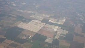温室和培养的领域从飞机窗口在夏时 图库摄影