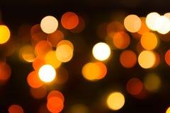 温暖的口气夜城市迷离bokeh 库存照片