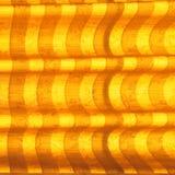 温暖的口气窗帘或帷幕和抽象自然阳光 库存照片
