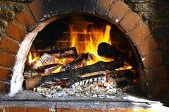 温暖的壁炉边 库存图片