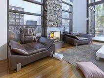 温暖的就座区域在现代房子里 免版税库存图片
