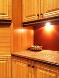 温暖的橙色颜色的厨房 库存图片