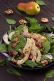 温暖的菠菜梨和烟肉沙拉 免版税库存照片