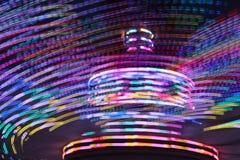 游乐园转动的光 免版税库存图片