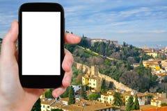 游人在佛罗伦萨拍摄老城市墙壁 库存图片
