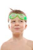 游泳佩带的男孩风镜 免版税库存图片