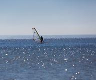 游泳在海的风帆冲浪者 库存图片