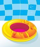 游泳床垫的孩子由池 免版税图库摄影