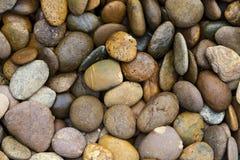 游泳池/庭院堆背景纹理小卵石 免版税图库摄影