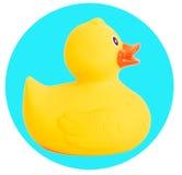 游泳的橡胶鸭子黄色玩具在白色 免版税库存图片