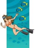 游泳的水下的妇女 免版税库存图片