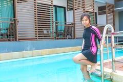 游泳衣在放松时间 免版税库存图片