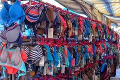 游泳衣在衣物市场上 免版税库存图片