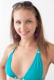 游泳衣的微笑的女孩 免版税库存图片