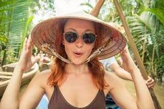 湄公河三角洲巡航的游人 库存照片