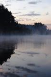 湖晚上白色木头 免版税库存图片