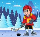 冻湖的冰球球员 免版税库存图片