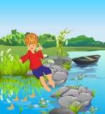 湖的男孩 库存图片