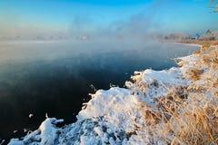 湖水和冰和雪日出 库存图片