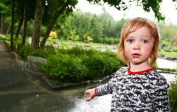 湿儿童的雨 库存图片