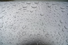 湿扶手栏杆 免版税库存照片