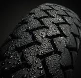 湿摩托车轮胎踩 库存照片