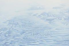 湿沙子抽象背景在海滩的 库存照片