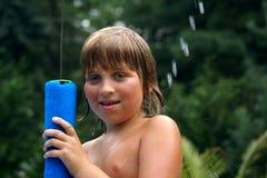 湿的男孩 库存照片