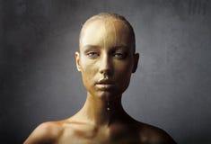 湿金黄的脸 免版税图库摄影