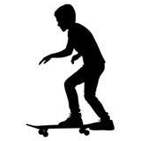 溜冰板者剪影 免版税库存照片