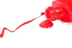 溢出的指甲油红色 查出在白色 免版税库存照片