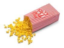 溢出的玉米花袋子 免版税库存图片