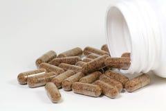 溢出的瓶药片 免版税图库摄影