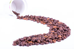 溢出的豆咖啡 免版税库存图片